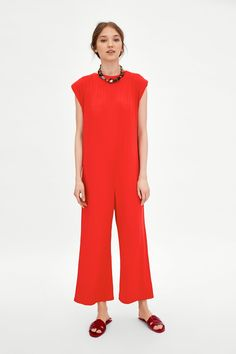 ad18224c92c Image 1 of LOOSE-FITTING RIBBED JUMPSUIT from Zara