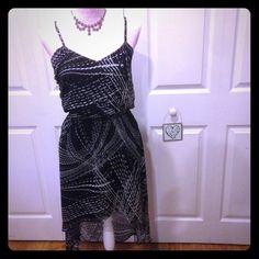 Express geometric dress Express black and cream lightweight dress. Adjustable spaghetti straps, hi-low hem, black lined. Super flattering material! EUC Express Dresses High Low