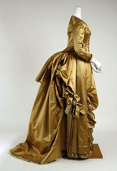 ca. 1885.  Can't you just imagine the sound this dress made as its wearer came walking into the room?