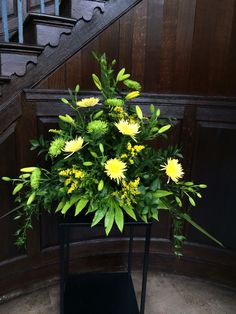 Church pedestal arrangement in yellow and green. Www.edenflorists.weebly.com
