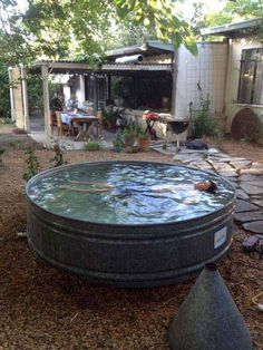 Make a pool/jacuzzi out of a horse trough