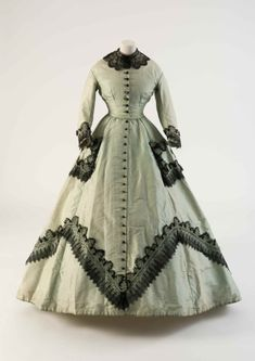 Fashion Museum Bath Light green silk dress with applied machine-made lace, 1860s