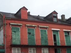 New Orleans Old Shutters   Old carriage tunnels into Courtyards