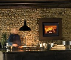 fireplace on the kitchen wall