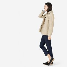 The classic trench, playfully recut    100% cotton  Fabric is a premium water-resistant cotton that's lightweight but still holds its structure  Features luxuriously lined sleeves and a traditional storm flap  Dry clean only