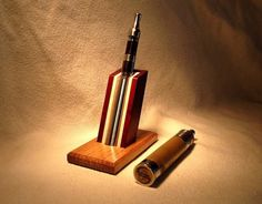 * These unique stands are designed and handcrafted to be beautiful as well as functional.  *This stand is made from Quartersawn Oak and African Padauk, however you can choose any of the woods from any of the stands you see in my shop. I use primarily exotic hardwoods such as African Padauk, Wenge, Zebrawood, Purpleheart, Bubinga, and many others. You can order stands with any combination of wood that you like. *This stand will accommodate most Mods and with an insert (see photo) that I will…