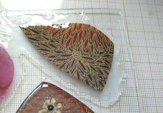Make beautiful pendants using pieces of fabric with liquid polymer