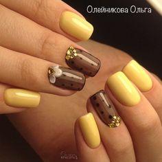 Nice yellow and sheer brown nail art.