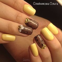 Nice yellow and sheer brown nail art.