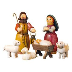 Holy Family. A 6-piece set of  color stained, hand-carved wooden Holy Family figurines packaged in a decorative wooden box.