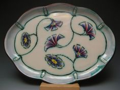 "Oval Platter with Iznik Carnations - 2010 H 1.75 L 17"" D 13"" Nova Scotia earthenware with slip, sgraffito and hand painted under-glaze decoration and glazes. Joan Bruneau - Studio Potter - Lunenburg Nova Scotia - Work"