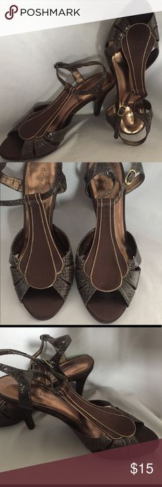Brown BCBGirls heels Brown snake skin and satin heels with small gold accent. Wore once. BCBGirls Shoes Heels