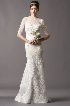 Watters Brides Kerry Gown Chantilly and corded lace with a stretch silk charmeuse slip dress Sweetheart illusion neckline with figure accentuating hand placed lace appliques and elbow length sleeves Fit and flare silhouette Sweep train  AVAILABLE AT MIRA BRIDAL COUTURE