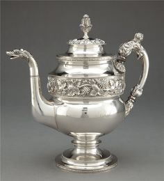 Am not a fan of silver teapots, but I thought this was rather lovely.