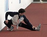 Stretching Exercises for Figure Skaters: Figure Skater Matthew Savoie Stretches Before a Practice Session at the 2006 Winter Olympics