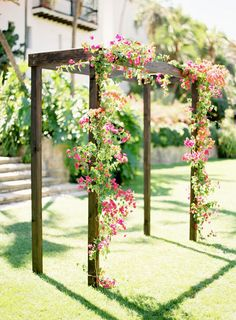 Simple, rustic arbor with fuchsia floral. #wedding #flowers #arch Wood Pergola, Pergola Plans, Outdoor Structures, Yard, Key, Simple, Doors, Wedding, Wooden Pergola