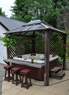 Hot tub cover provides you an ultimate relaxing time while enjoying the natural surrounding in your backyard. Find some amazing hot tub enclosure ideas here! tub gazebo ideas Most Mesmerizing and Super Cozy Hot Tub Cover Ideas Hot Tub Gazebo, Hot Tub Deck, Hot Tub Backyard, Hot Tub Bar, Hot Tub Garden, Jacuzzi Outdoor Hot Tubs, Oasis Backyard, Jacuzzi Hot Tub, Backyard Pavilion