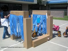 Amazing bike Car Wash ~ How fun is that. Use cheap plastic table cloths for the streamers ~ brilliant Amazing bike Car Wash ~ How fun is that. Use cheap plastic table cloths for the streamers ~ brilliant Role Play Areas, Dramatic Play Centers, Transportation Theme, Preschool Transportation, Outdoor Classroom, Outdoor Learning, Outdoor Play, Outdoor Games, Play Centre