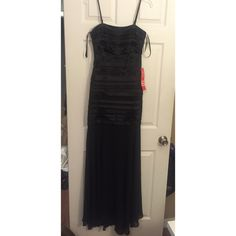 New long formal dress Beautiful long black dress for a formal occasion. The tag ripped but this has never been worn. Size 9/10. Dresses