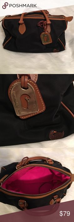 Dooney & Bourke | Vintage Tote Gorgeous DB kept in beautiful shape. Absolutely clean; no marks. Exterior is black, interior hot pink. Camel colored leather trim & brass hardware as well as DB tag in front. One zip pocket & one slip pocket inside. Let me know if you have any questions. Bundle to save & happy Poshing! Dooney & Bourke Bags Totes