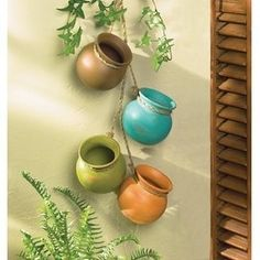 Our southwest aged clay hanging pots will make a charming rustic addition to your interior or patio decor. This item includes 6 clay pots dangling from rope. Southwestern Decorating, Southwest Decor, Southwest Style, Hanging Planters, Planter Pots, Diy Hanging, Hanging Terrarium, Mexican Restaurant Decor, Mexican Wall Decor