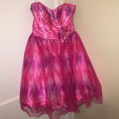 Pink & Purple Prom / Sweet 16 Dress This cute strapless dress is great for a homecoming, prom, sweet 16, wedding etc. Its flowy and sparkly. I purchased it for a Sweet 16 and never wore it. The flower is removable. Comes with thin pink straps that can be sewn into dressThere are one size fits all cups built into the dress, also removable by a seamstress. Price is adjustable. If you have any questions please feel free to ask!! Clarisse Dresses Strapless