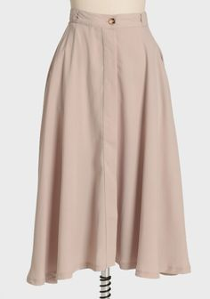 """Daytime Leisure Midi Skirt Take a twirl in our chic asymmetrical high-waisted beige skirt. Finished with side pockets and front button closure.  100% Polyester Imported 28.5"""" length from top of waist 27"""" waist"""