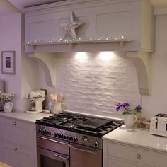 Something like this would be good to finish my kitchen. I could install a cooker extractor hood and use this to hide the pipes on the wall. Plus, looks pretty with Christmas lights.