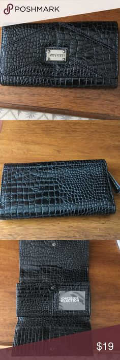 Kenneth Cole Reaction Black Wallet Kenneth Cole Reaction black faux patent snake skin leather. Snap closure with multi compartments to hold credit cards, cash, coins and a lot more. Never used. All questions and negotiations welcome. Kenneth Cole Reaction Bags Wallets