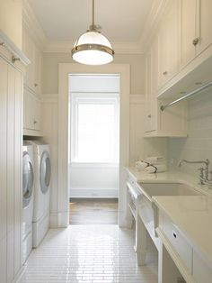 Perfect Laundry room. I love the cabinets, millwork, hardware,  faucet, countertop, and raised washer/dryer. I would have a contrasting floor and darker backsplash though.
