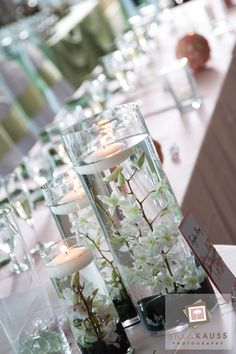 Orchid vases with floating candles