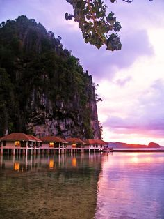 Sunrise at the Miniloc Island Resort, El Nido. The iconic image of this resort as well as other properties of the El Nido Resorts is the . Palawan Island, El Nido Palawan, Honeymoon Style, Honeymoon Destinations, Romantic Places, Beautiful Places, Landscaping Retaining Walls, Philippines Travel, Island Resort