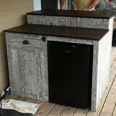 Custom outdoor bar with mini fridge, storage cabinet and drawer, finished in driftwood