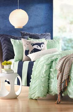 Beautiful blue and green bedding. Love the mix of ruffles, stripes and chevron patterns.