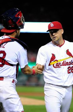 ST. LOUIS, MO - AUGUST 6: Trevor Rosenthal #26 of the St. Louis Cardinals is congratulated by Tony Cruz #48 after the seventh inning against the Los Angeles Dodgers at Busch Stadium on August 6, 2013 in St. Louis, Missouri. (Photo by Jeff Curry/Getty Images)