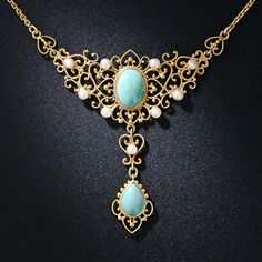 They don't come much sweeter than this ravishing necklace, dating from the turn-of-the twentieth century, by the renowned American jewelry manufacturer - Krementz. This thoroughly feminine jewel is composed of bright, light turquoise and shimmering freshwater pearls and is fancifully adorned with delicate filigree scrolls and hearts