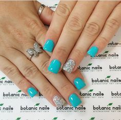 Turquoise nails with glitter accent nail