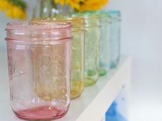 How to tint Mason jars.    Supplies:    Mason Jars  Mod Podge in Gloss (buy it here)  Food coloring  Ramekins to mix colors  Newspaper or paper bag    Mix food coloring with a T or so of water into individual ramekins. You can do any color combination you like.    Add a couple T of mod podge into your mason jar    Add one ramekin of color into the