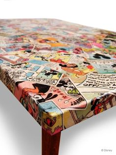Take old table or desk and decoupage with comics or old picture book pages for the kids rooms or play area // from 25-dorm-decor-diy-ideas