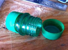 two identical bottle tops, cut at large flange, glue using a large.  Use Juice bottles for a larger size!