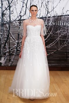 """Brides.com: Mira Zwillinger - 2014-2015%0A""""Charlie"""" strapless A-line wedding dress with a sweetheart neckline and applique details, shown with illusion high-neck cape, Mira ZwillingerPhoto: Thomas Iannaccone"""