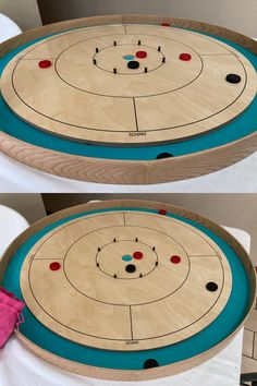 I have something to confess. I have never played this game with my nephew, but it will be a hit with kids, I can just tell. You flick discs on a board, what's not to like?  You each have 12 discs and take turns flicking them onto the board. The disc must land in the innermost circle (15 points) if the board is empty. #boardgames #crokinole Crokinole Board, Board Games, Boards, Great Hobbies, 8 Year Olds, Games To Play, Woodwork, Empty, Alice