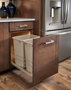Kitchen Design Idea - Hide Pull Out Trash Bins In Your Cabinetry // If lids aren't for you leave them off and make accessing the trash that much easier.