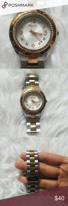 Beautiful two toned relic watch This watch is gorgeous! I'm a big watch collector and I absolutely adore this watch.  30 meters/100 feet away water resistant All stainless steel Needs battery Relic Accessories Watches