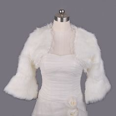 Lace Trimmed Ivory Faux Fur Bridal Jacket Category:CoatsOccasion:Wedding/Special OccasionSeason:WinterSleeve Style:Three-quarter SleeveFabric:Faux FurShoulder:40Shoulder to Bottom:31Sleeve:37 Only $18.69 USD
