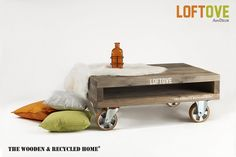 Loftove – coffee table on wheels  From our Loftove collection, this coffee table is made of recycled wood. The idea behind the entire collection comes from our fascination with industrial style and objects that are patterned after heavy furniture and factory-made cabinets. The entire construction is made of recycled wood subjected to the natural process of oxidation. Substantial but easy rolling wheels can aid in moving heavy furniture. The entire surface is waxed.