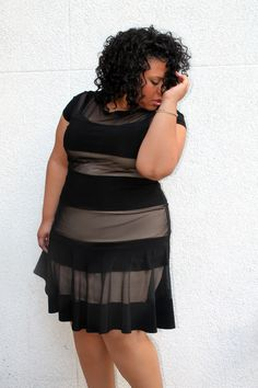 Plus size fashion #slimmingbodyshapers This versatile plus size dress is sure to become your go to for office parties, dressy occasions and a night on the town! A classic plus size cocktail dress in a shape that flatters every body type slimmingbodyshapers.com