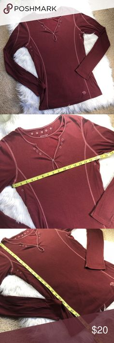 Mountain Hardwear baselayer long sleeve tee Mountain Hardwear Maroon baselayer long sleeve shirt. Says it's a men's medium, but a woman medium or large could definitely fit this! I think the style looks more feminine anyways! Excellent condition! Material tag is cut out. Measurements on pictures! Make a bundle and offer to save! :) Mountain Hardwear Tops Tees - Long Sleeve