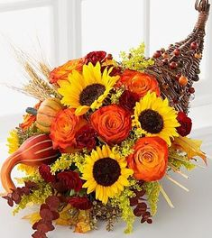 Thanksgiving Floral Centerpieces Three Awesome Thanksgiving Flowers and Floral Arrangements Thanksgiving Floral Centerpieces. Thanksgiving flowers are a wonderful way to brighten up your dining roo… Flower Arrangement Designs, Fall Floral Arrangements, Floral Centerpieces, Thanksgiving Flowers, Thanksgiving Decorations, Thanksgiving Cornucopia, Thanksgiving Feast, Seasonal Flowers, Fall Flowers
