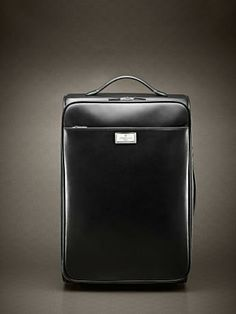 Nappa calfskin carry-on with retractable mechanism and two sliding handles. Address holder on the back and label with logo in polished palladium-finish solid brass with brushed edges. Jacquard lining. Inside: two adjustable clothes straps and one zipped pocket. cm 42x30x6. #ss14 #men #accessories